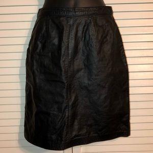 Dresses & Skirts - Black leather skirt Size 3/4.